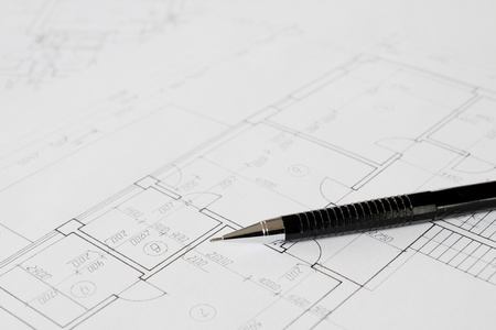 Plans and black pencil on the table photo