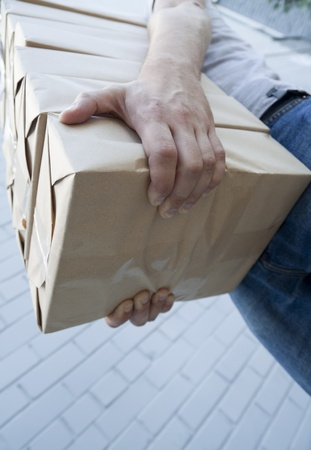man holding a pile of package parcels photo
