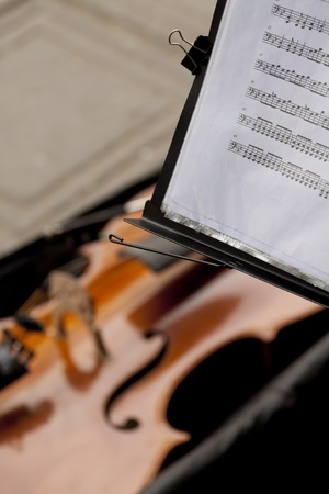 Notation and violin. Street music. photo