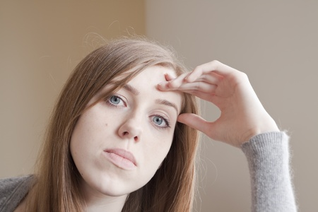 Sad young woman sitting on the bed Stock Photo - 10396610