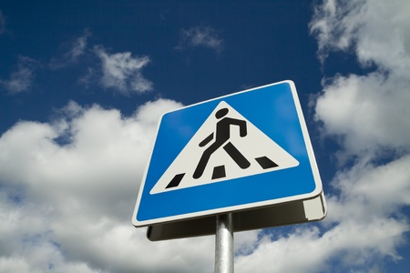 Crosswalk road sign on a sky background photo