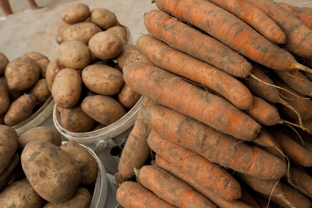 Potato and carrot on local market photo