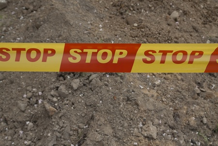 Restricting area strip with written STOP sign Stock Photo - 10758861