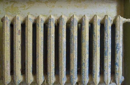 Old radiator in the dark stairwell Stock Photo - 10883257