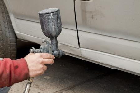 Hand holding spray paint gun