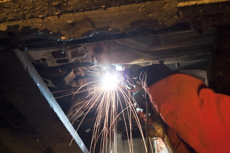 Welding works in the repair shop photo