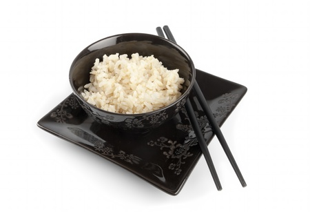 Boiled rice in a ceramic bowl and chopsticks isolated on white Stock Photo - 11845692