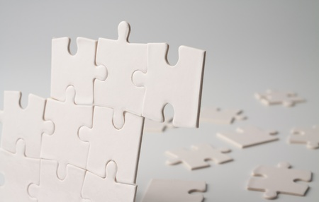 Assemble the puzzle piece by piece Stock Photo - 11966791