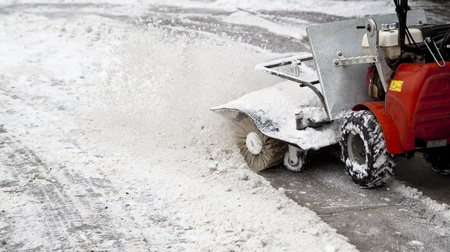 snow blowing machine in the street photo