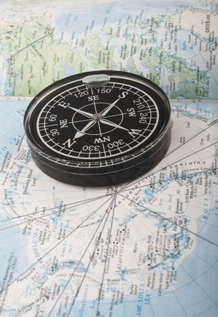 Compass on the map indicating south pole photo
