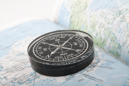 guideline: Compass on the map indicating south pole Stock Photo