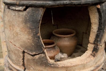 kiln: Old pottery kiln and pot. Pottery theme