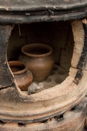 Old pottery kiln and pot. Pottery theme