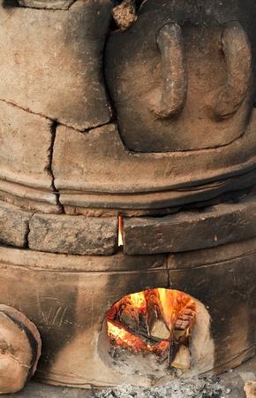 kiln: Old pottery kiln and fire