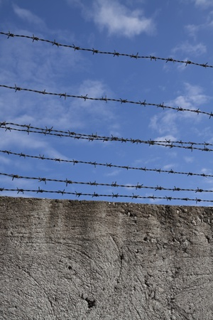Barbed wires and blue sky photo