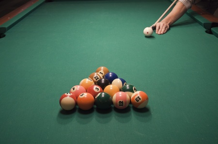 The start of the game of pool (billiard). Episode of pool game play photo