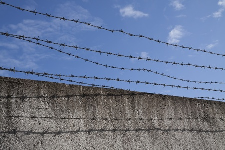 Barbed wires and blue sky Stock Photo - 12843058