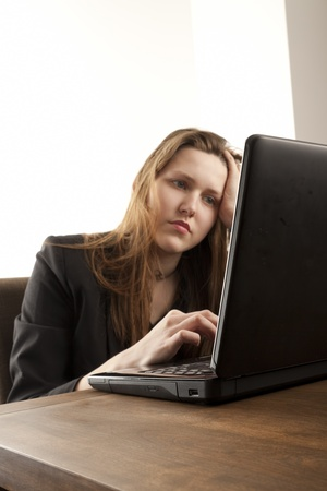 Girl using a laptop to browse the net photo