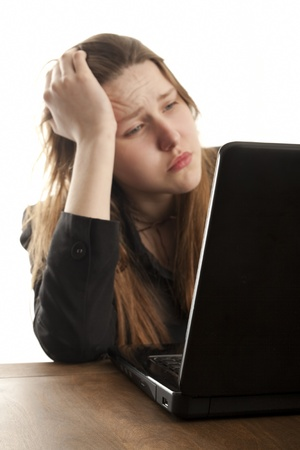 wireless woman work working: Sad girl using a laptop to browse the net Stock Photo