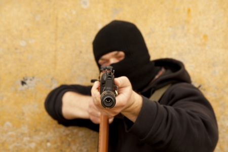 Man in mask with gun Stock Photo - 13299375