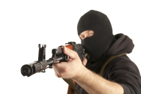 attacker: Man in mask with gun on white background