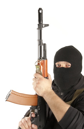 Man in mask with gun on white background Stock Photo - 13485545