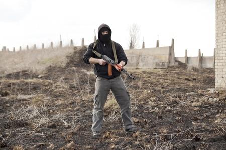 aggressor: Warrior with gun in the battlefield