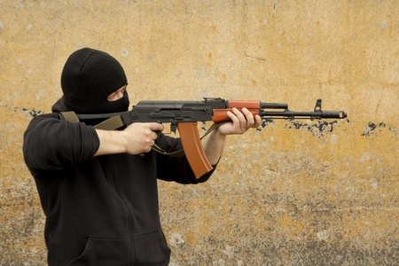Man in mask with gun Stock Photo - 13545910