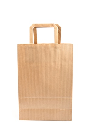 Paper bag on white background. Consumerism symbol. photo