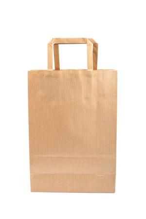 consumerism: Paper bag on white background. Consumerism symbol.