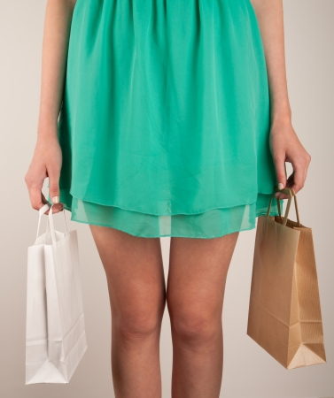 Girl with paper bags. Consumerism symbol. Stock Photo - 14230339