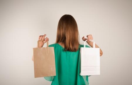consumerism: Girl with paper bags. Consumerism symbol.