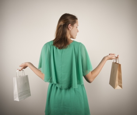 Girl with paper bags  Consumerism symbol  photo