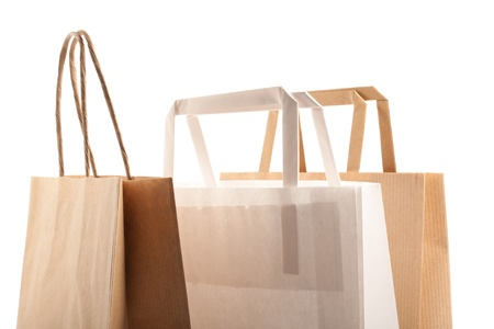 Paper bags on white background. Consumerism symbol. Stock Photo - 14350205