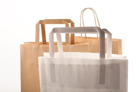 Paper bags on white background. Consumerism symbol. Stock Photo - 14350207