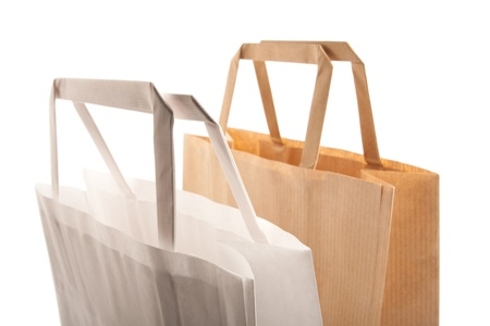 Paper bags on white background. Consumerism symbol. Stock Photo - 14350203