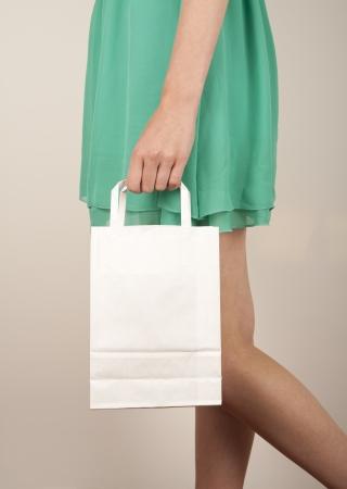 Holding paper bags. Consumerism symbol. Stock Photo - 14428312