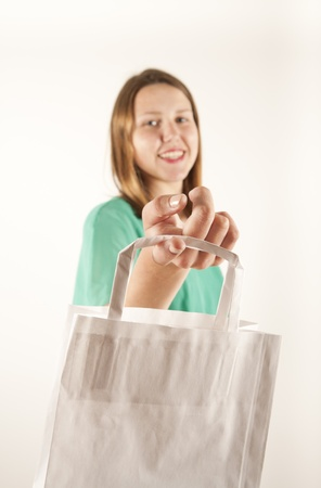 Girl with paper bag. Consumerism symbol. Stock Photo - 14539692