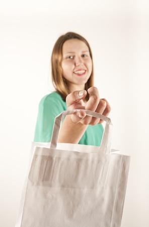 Girl with paper bag. Consumerism symbol. Stock Photo - 14539692