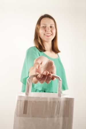 consumerism: Girl with paper bag. Consumerism symbol. Stock Photo