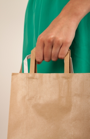 Girl holding paper bags. Consumerism symbol. photo