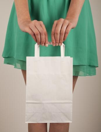 consumerism: Holding paper bags. Consumerism symbol. Stock Photo