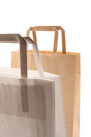 Paper bags on white background. Consumerism symbol. photo