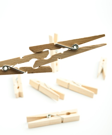 Wooden pegs on white background Stock Photo - 17306241