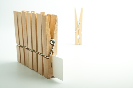 Wooden pegs on white background Stock Photo - 17306244