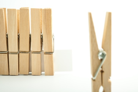 Wooden pegs on white background Stock Photo - 17306246