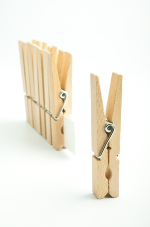 Wooden pegs on white background Stock Photo - 17306243