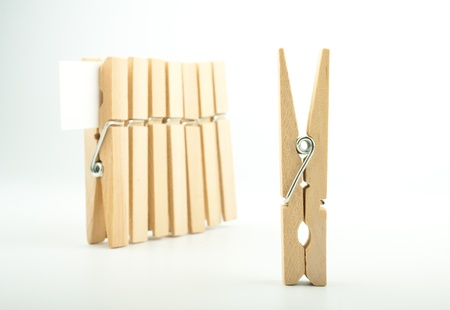 Wooden clothes pegs on light background Stock Photo - 17334553