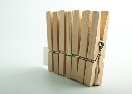 Wooden clothes pegs on light background Stock Photo - 17334869