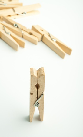 Wooden clothes pegs on light background Stock Photo - 17334571